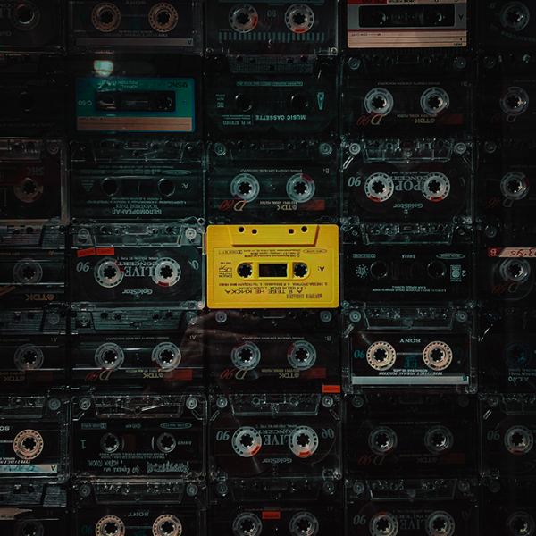 music playlist. cassette tapes lined up in rows.